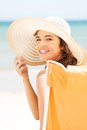 Woman over seaside sunny day beautiful young in a hat and swimsuit Stock Photo