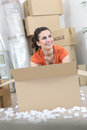 Woman with packing boxes positive Stock Photos