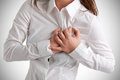 Woman in pain having a the heart area Royalty Free Stock Image