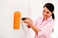 Woman with a paint roller Stock Images