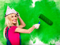 Woman paint wall at home happy Royalty Free Stock Photography