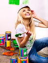 Woman paint wall at home happy Stock Photo