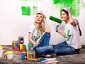 Woman paint wall at home happy Royalty Free Stock Photo