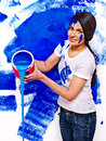 Woman paint wall at home happy Stock Photos