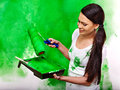 Woman paint wall at home happy Stock Images
