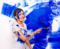 Woman paint wall at home happy Royalty Free Stock Photos