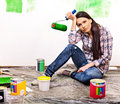 Woman paint wall at home unhappy Stock Photo