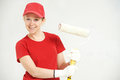 Woman painter worker with roller smiling female house painting Stock Images