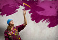 Woman painter young in bandana with paintbrush in hand Royalty Free Stock Photo