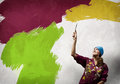 Woman painter young in bandana with paintbrush in hand Royalty Free Stock Photos