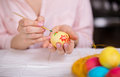 Woman painting easter eggs young Stock Photo