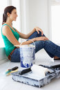 Woman painting house Royalty Free Stock Images