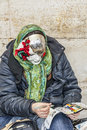 Woman painting masks venice italy march unidentified in a mask drawing a mask near the doge s palace walls in san marco sqaure Stock Photos