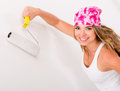 Woman painting a wall Royalty Free Stock Images