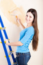A woman is painting walls Stock Photos