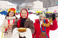 Woman with pancakes during  Shrovetide Stock Photo