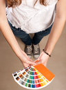 Woman with pantone palette young holding a Stock Images