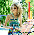 Woman in park at sunny day Stock Photo