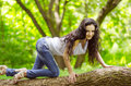 Woman in park young wouman on tree summer Stock Image