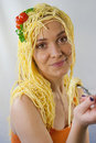 Woman with pasta on her head happy spaghetti Royalty Free Stock Photos