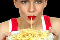Woman with pasta nice image of a beautiful eating on black Stock Photography
