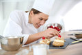 Woman pastry chef preparing desert Royalty Free Stock Photo
