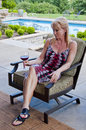 Woman on patio with wine glass Stock Photo