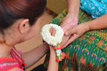A woman pay homage with Thai traditional jasmine garland on her hands. Royalty Free Stock Photo