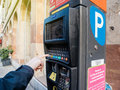 Woman paying for parking at the new Parking ticket payment machine Royalty Free Stock Photo