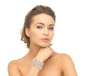 Woman with pearl earrings and bracelet Royalty Free Stock Photo