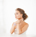 Woman with pearl earrings and bracelet beautiful wearing Stock Photography