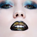 Woman with pearl glamour make-up and black lips Stock Image