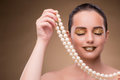 The woman with pearl necklace isolated on white Royalty Free Stock Photo