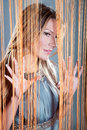 Woman peeking through the curtain Royalty Free Stock Photography