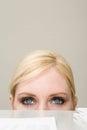 Woman peeking over filing cabinet Royalty Free Stock Photo