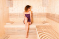 Woman with perfect skin taking body treatment in sauna Royalty Free Stock Photo