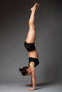 Woman performing handstand Royalty Free Stock Photo