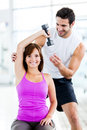 Woman with a personal trainer Stock Photos