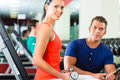 Woman and Personal Trainer in gym, with dumbbells Royalty Free Stock Photo
