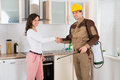 Woman And Pest Control Worker Shaking Hands Royalty Free Stock Photo