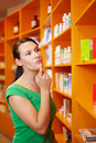 image photo : Woman in pharmacy thinking