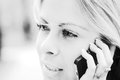 Woman on the phone black and white close up of a nice young talking high key Stock Photo