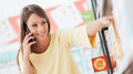 Woman phone calling at the store Royalty Free Stock Photo