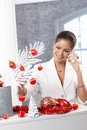 Woman on phone decorating for christmas portrait of smiling elegant talking mobile Royalty Free Stock Images
