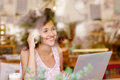 Woman on the phone smiling while in a coffee shop Royalty Free Stock Photo