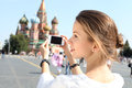 Woman photographed attractions in moscow young Royalty Free Stock Photography