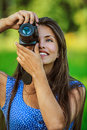 Woman photographed with camera Royalty Free Stock Image