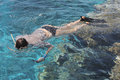 Woman photographer diving into water of red sea a Stock Photography