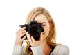 Woman photographer with dslr at work Stock Images