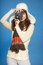 Woman photographer making picture of you looking through the photo camera viewfinder at over blue background Royalty Free Stock Images